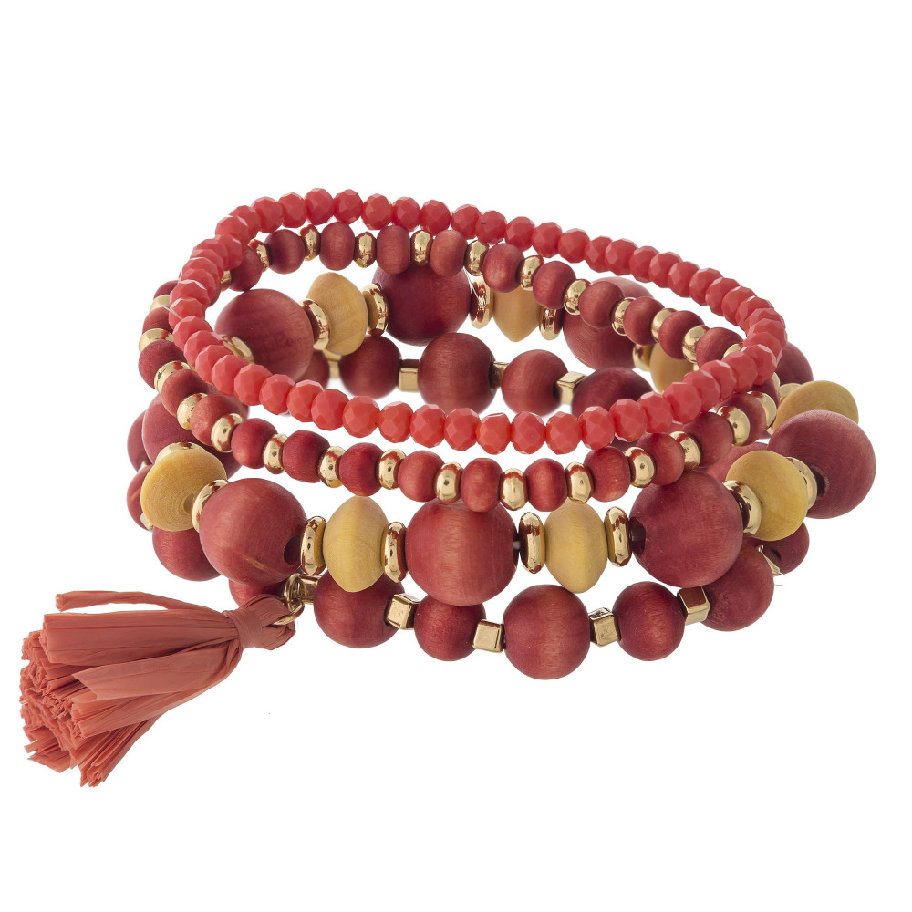 Wood beaded stretch bracelet set with a raffia tassel accent.